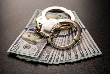entrap: Handcuffs and money on the table