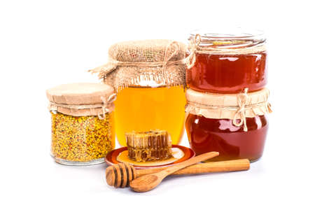drizzler: Still life with honey, honeycomb, pollen and propolis on a white background