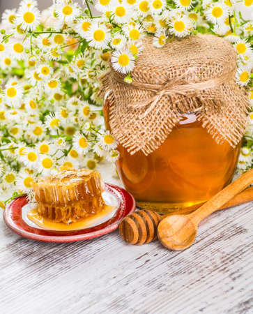 drizzler: Still life with honey, honeycomb, pollen and propolis Stock Photo