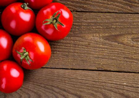 fresh, ripe tomatoes on wood background Stock Photo