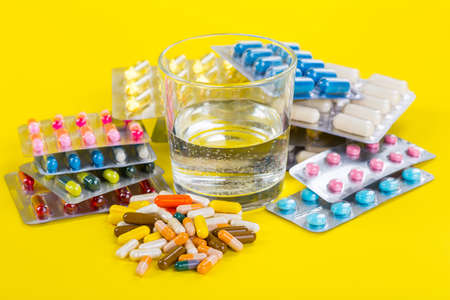 Selection of different pills in form of tablets and capsules