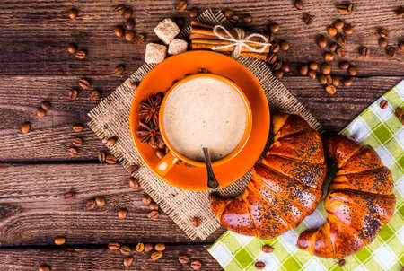 Coffee cup and coffee beans on table Stock Photo