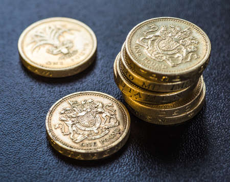 sterling: British coins stack on black, pound sterling