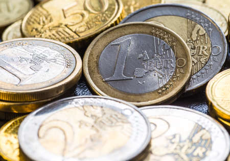 five cents: Euro coins. One Euro coin on the foreground.