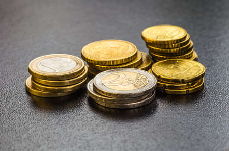 Euro coins. One Euro coin on the foreground.