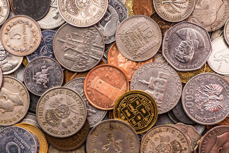 bani: Coins of several currencies - background pattern.