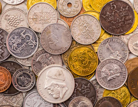 leu: Coins of several currencies - background pattern.