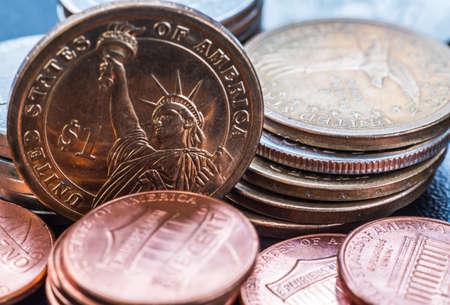 dollar coins stack on black