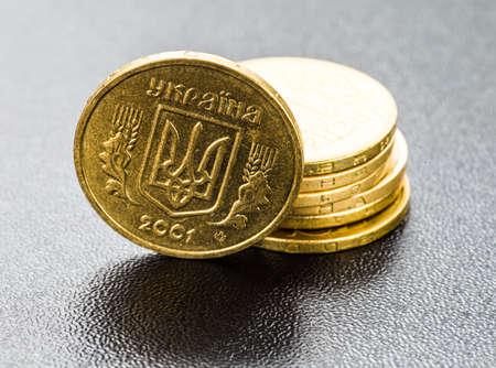 Coins of Ukraine stack on black.
