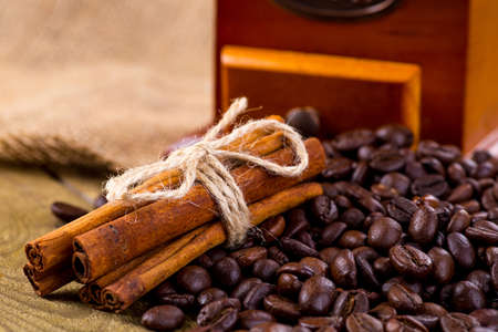 coffee grinder: Coffee cup and beans, old coffee grinder and canvas sack Stock Photo