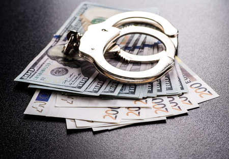 handcuffs: Handcuffs and money on the table