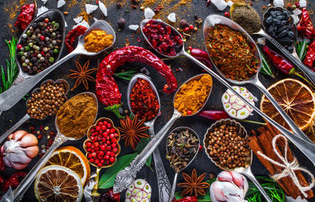 Spices and herbs in metal bowls. Food and cuisine ingredients. Colorful natural additives. Stock Photo