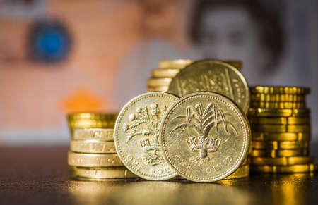 British coins stack on black, pound sterling