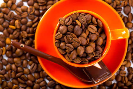 clutter: A coffee mug of coffee beans Stock Photo