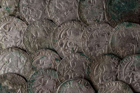 Closeup view of medieval European silver coins. Suitable for an abstract background. 스톡 콘텐츠