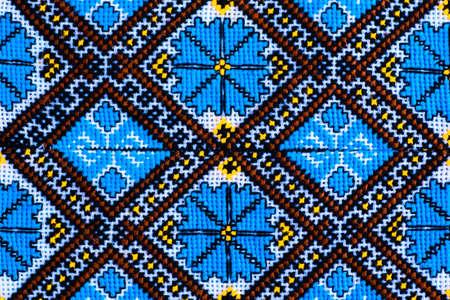 Close-up beautiful Ukrainian traditional style embroidery. Vyshivanka. Banco de Imagens