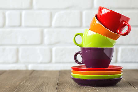 Tea, coffee cups stacked. Neutral background. Space for text.