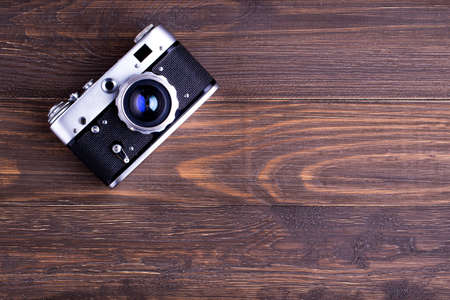 Vintage camera on wooden background,top view Stok Fotoğraf