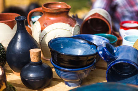 Ukrainian pottery. Pottery museum in Ukrainian village Oposhnya, center of Ukrainian pottery production. Different pottery products: bowls, pitchers, plates in museum. Stok Fotoğraf