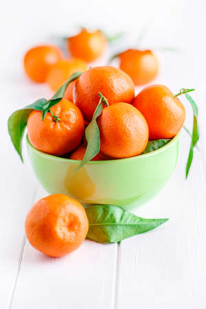 bowl of fresh mandarins, straight from the tree Stock Photo