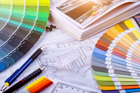 Interior designers working table, an architectural plan of the house, a color palette. Drawings and plans for house decoration.Construction concept: plan , color samples , roller Reklamní fotografie