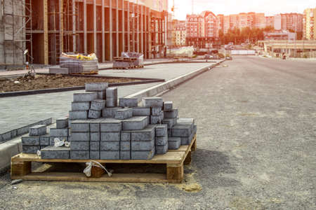 Paving bricks ready for construction work. Laying paving slabs on a city square, sidewalk