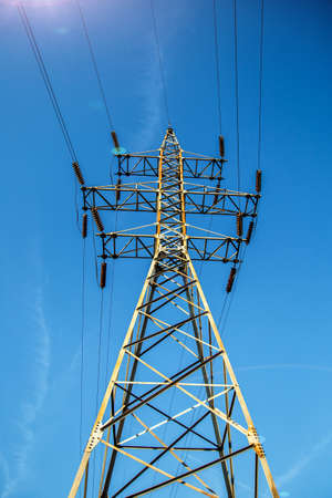 High-voltage power lines.Electricity pylon.Power Tower.Distribution electric substation with power lines and transformers.Electricity transmission power lines at sunset