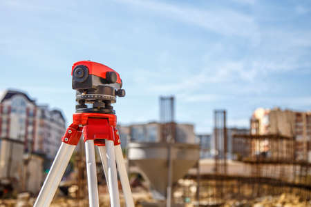 Surveyor equipment GPS system or theodolite outdoors at highway construction site.Measuring instrument close-up. Surveyor engineering with total station