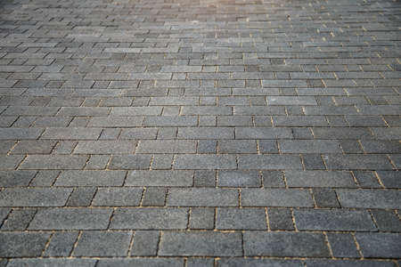 Perspective View of Monotone Gray Brick Stone on The Ground for Street Road. Sidewalk, Driveway, Pavers, Pavement in Vintage Design Ground Flooring Square Pattern Texture Background for mock up
