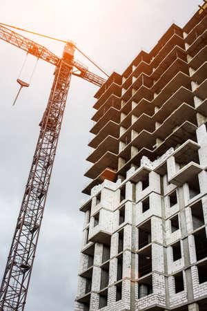 Construction site background. Hoisting cranes and new multi-storey buildings. I.ndustrial background.Building construction site work against blue sky Reklamní fotografie