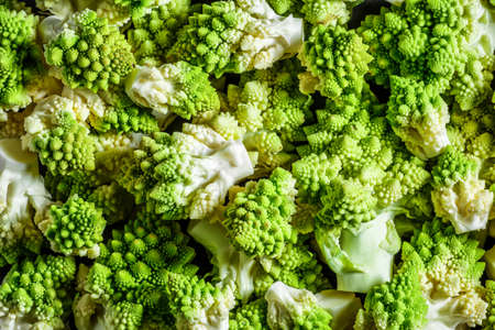 Romanesco broccoli or Roman cauliflower, close up shot from above, texture detail of the healthy vegetable Brassica oleracea,Vegetables for diet and healthy eating.Organic food.
