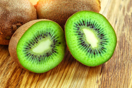 Kiwi fruit on brown wooden background. Kiwi fruit is sweet and sour taste, nutritive value and high-fiber.selective focus