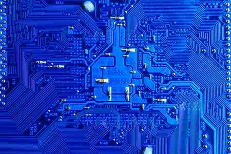 blue circuit board background of computer motherboard,Electronic computer hardware technology.Integrated communication processor. Information engineering component. Blue color. Stock Photo