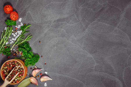 Fresh herbs and spices on black stone table. Cooking concept.Free space for your text. Rustic style. Copy space