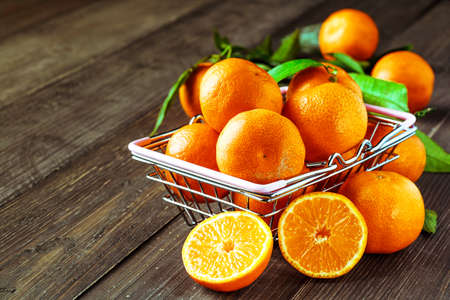 Fresh oranges on a wooden table