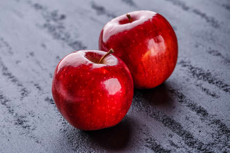 Group of red apples with their leaves. Top view with space for your text