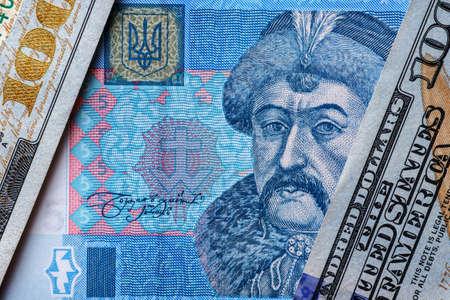 Ukrainian money - hryvnia banknotes USA dollars bills. Finance in Ukraine, of the hryvnia to the dollar exchange rate. World economic crisis associated with coronovirus.