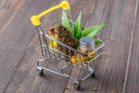 supermarket trolley marijuana medical cannabis oil cbd,cannabis,Essential oil made from medicinal cannabis.Cannabis herb and leaves for treatment.Buds. Skunk. cbd
