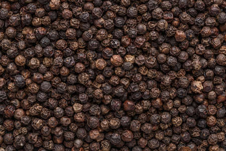 Peppercorn background. Dry black pepper seeds. Top view. Flat design. Macro spice background 스톡 콘텐츠