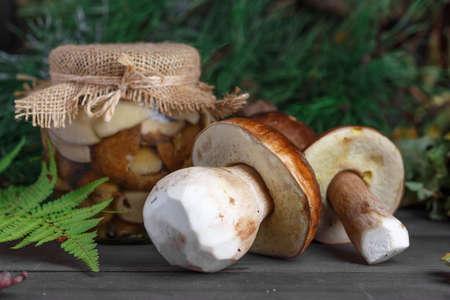 Mushroom Boletus in wooden wicker basket. Boletus edulis over Wood Background, close up on rustic table.  Cooking delicious organic mushroom. Gourmet food,Autumn Cep Mushrooms. Mushrooms Picking 스톡 콘텐츠