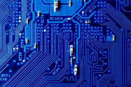 blue circuit board background of computer motherboard, Electronic computer hardware technology.Integrated communication processor. Information engineering component. Blue color.
