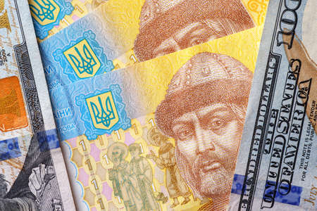 Ukrainian money - hryvnia banknotes USA dollars bills. Finance in Ukraine, of the hryvnia to the dollar exchange rate. World economic crisis associated with coronovirus.