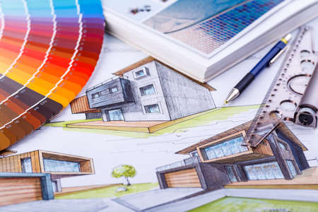 Interior designer's working table, an architectural plan of the house, a color palette. Drawings and plans for house decoration.Construction concept: plan, color samples, roller