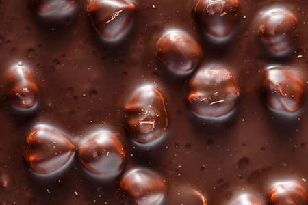 Chocolate background with nuts. Sweet food photo concept. Delicious dessert. Popular sweets.