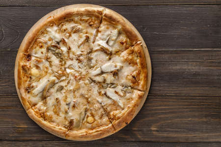 Fresh pizza with, black olives, mozzarella cheese, ham on wooden table closeup. Space for text or copy space. Pizza menu. Restaurant menu advertise 스톡 콘텐츠