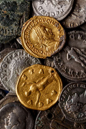 A treasure of Roman gold and silver coins.Trajan Decius. AD 249-251. AV Aureus, Ancient coin of the Roman Empire, Authentic silver denarius, antoninianus, aureus of ancient Rome, Antikvariat.