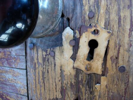 Close-up of an old doorknob and keyhole photo