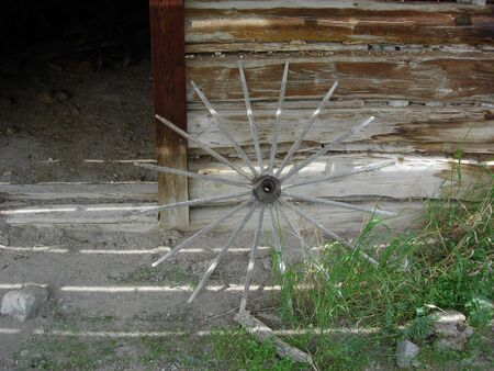 spokes: Wheel spokes against an old building