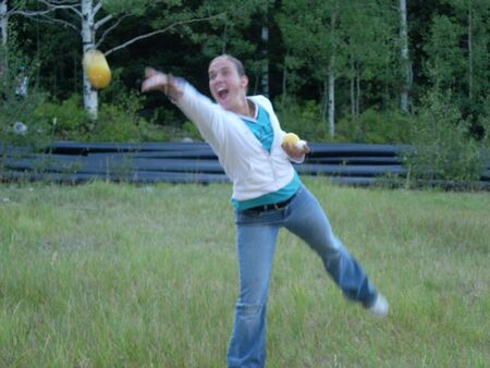 A young woman throwing a ball
