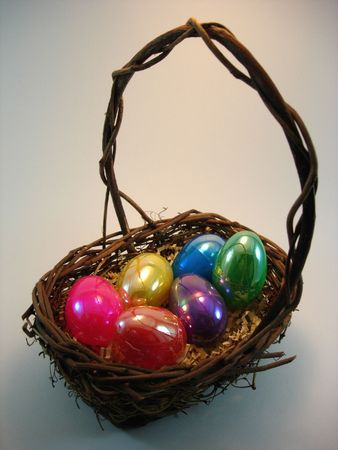 An Easter basket full of bright colorful eggs